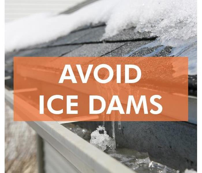 Picture of an ice dam, water that has iced over enough to prevent water draining, in a gutter of a house.